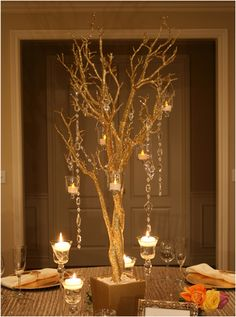 This looks fab when twigs are placed in a tall glass vase with hanging glass tlight holders. I have done this before at a wedding in the UK.
