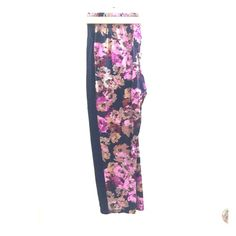 Anthropologie floral pants Anthropologie (Lilka brand) elastic waist (wide waistband) floral pants. Size Large. Zipper front pockets. Black side stripes/panels. Straight leg. One back pocket. Worn twice. Anthropologie Pants