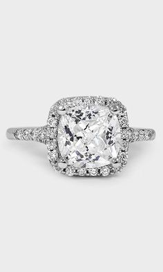 An amazing 3 carat cushion diamond shines at the center of the Harmony Diamond Ring.