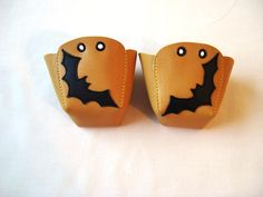 Yellow leather Roller Derby skate toe guards with black BATS - Bea needs these with a bee on them!!!