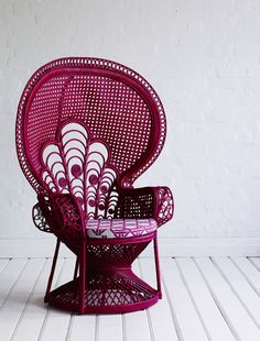 or do i like the magenta peacock wicker chair?