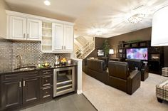 Love this Basement-- this is kind of what our kitchen/ dining room will look like, except a bead board back splash, with the dark lowers and white uppers, and grey paint in the dining room :)