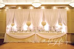 Wedding Backdrops- notice how there is a table directly behind the front table, propped up on staging.