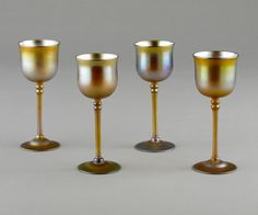 Tiffany Studios (American, est. 1902). Iridescent goblets, early 20th century. Favrile glass. Photo by John Faier, © The Richard H. Driehaus Museum.