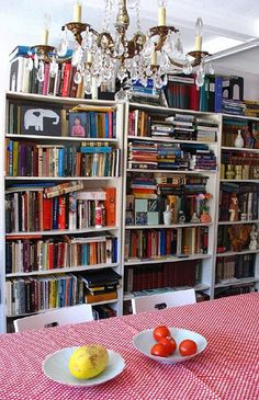 I'm pretty sure my house will look like this one day. I have waaaaay too many books for my own good.  :D