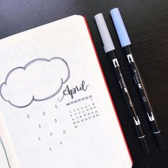Bullet journal monthly cover page, April cover page, rain cloud drawing. | @cherylsbujo