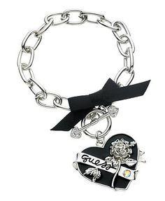 GUESS Bracelet, Jet and Crystal Heart Charm Toggle Bracelet. Really don't like branded stuff, but this is cute.