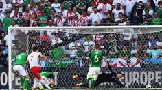 Northern Ireland's first match at a European Championship finals ended in defeat as Arkadiusz Milik's 51st-minute goal gave Poland a 1-0 win in Nice.