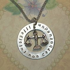 Illegitimi Non Carborundum Hand Stamped Sterling Silver Scales of Justice Necklace. $40.00, via Etsy.