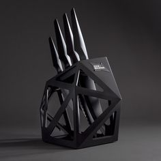 Black Diamond Knife Block Black Diamond is a unique, angular float knife block. Christian Bird¡¯s design is faithful to Edge of Belgravia¡¯s avant-garde hallmark. Futuristic in conception,