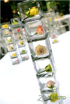 simple arrangements, rose buds for your wedding reception....tulips instead
