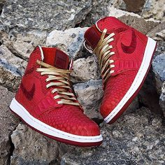 These AJ1's by @jbfcustoms are reconstructed with genuine red python and sueded croc skins. The metallic gold leather laces by @aglit_italy are a nice touch. #aceofcustoms
