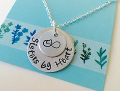 A personal favorite from my Etsy shop https://www.etsy.com/listing/465309775/sisters-by-heart-necklace-best-friend