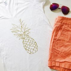 "Pineapple Top Pineapple Top featuring gold metallic graphic print.  Oversized vneck boyfriend tee.  NWOT, never worn!  Boutique brand.  Please see measurements for available sizes.  Listing is for 1 top.  Measurements laying flat: Size MEDIUM Armpit to armpit: 18"" Waist (across): 16"" Total length: 26""  Size LARGE Armpit to armpit: 20"" Waist (across): 18"" Total length: 27"" Charm City Tops"