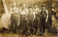 Sepia photograph of five Victorian steelworkers. In Victorian times steelworkers started working as young as six years old. Work was dangerous, with little protection from the dangers of molten hot steel. ©Sheffield Industrial Museums Trust