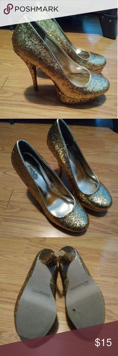 Gold Glitter Pumps Never worn outdoors, only worn around the house hence the black spot of make up on the bottom of the shoe shown in the last photo. Charlotte Russe Shoes Heels
