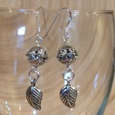 CLEARANCE 🎉Leaf dangle silver earrings These earrings are made with Tibetan silver beads and charm. The ear wires are 925 Sterling silver. They hang about 1 1/4 inches. Handmade by me NWOT. I now have the plastic earring stoppers Jewelry Earrings