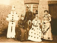 A group of 1900s era clowns pose for a rather formal looking portrait (given their profession, I mean). Don't you just love the ladies' whimsical costumes?