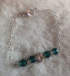 Green crystals, celtic diamond on a link made by me with silver chain.