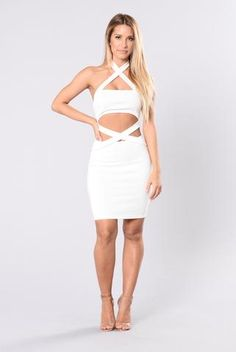 - Available in Black and Ivory - Criss Cross Neckline and Front - Front Cutout - Knee Length - Made in USA - 87% Polyester 10% Rayon 3% Spandex
