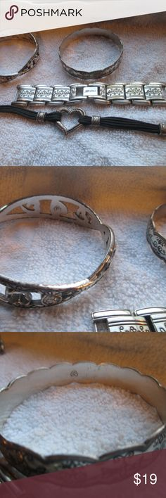 4 Brighton lot bangles bracelet watch band  used Brighton lot bangles bracelet watch band  used sold as is  2 bracelets show much wear need cleaning heart bracelet shows wear tarnish needs cleaning  band is like new all included Brighton Jewelry Bracelets