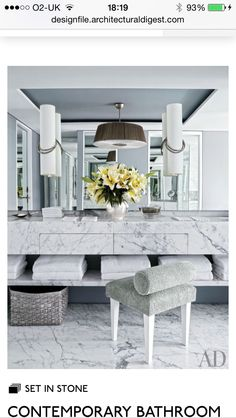 Like the design of sink unit with drawers and open shelving underneath - materials are too over polished- too much marble