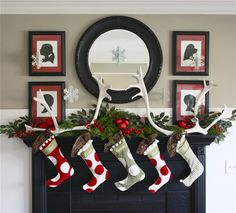 okay...how awesome would a round mirror look over the fireplace with antlers over the top of the mirror? and of course this is a cool setup for Christmas at The Keene's