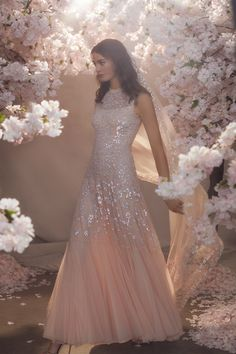 The latest bridal collection by Needle and Thread features the British band's iconic use of sparkling sequins and lattice beading upon chiffon and tulle. Click the link to view the full collection! Wedding Dresses Uk, Bridal Dresses, Bridesmaid Dresses, Prom Dresses, Modest Dresses, Wedding Bouquets, Needle And Thread Wedding Dresses, Traditional Gowns, Sequin Midi Dress
