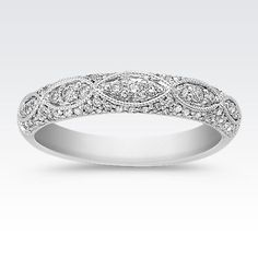 Seventy-three round diamonds, at approximately .35 carat total weight, sparkle and shine in this vintage inspired band. The band is crafted from quality 14 karat white gold. This stunning design will look great with any ring or wear it alone for a classic look.
