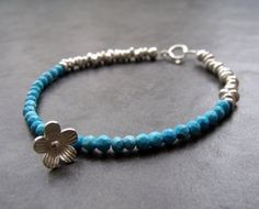 Turquoise Rondelle with Hill Tribe Flower Charm and Nugget