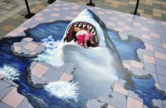 Some more amazing sidewalk art. (The little girl is completely safe.)