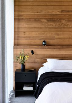 A simple monochromatic palette allows the timber feature wall to shine in this bedroom in a home on the Mornington Peninsula by Planned Living Architects. Cedar Walls, Timber Walls, Timber Beds, Timber Panelling, Timber Bedhead, Wood Walls, Wood Paneling, Timber Feature Wall, Feature Wall Design