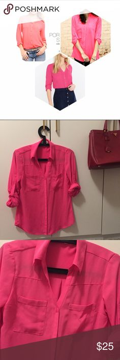 Express Pink Portofino Shirt Slim fit, point collar, notch neckline, button front Long convertible sleeves with roll tabs Patch pockets, shirttail hem; Semi-sheer crepe fabric Petite: perfectly proportioned body & sleeve lengths Polyester.  You can style this in so many ways! Bundle with other colors and save more  Express Tops Button Down Shirts