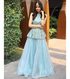 Turq blue halter neck peplum top with matching organza skirt only on KalkiYou can find Designer dresses indi. Party Wear Indian Dresses, Designer Party Wear Dresses, Indian Gowns Dresses, Dress Indian Style, Indian Fashion Dresses, Indian Wedding Outfits, Indian Designer Outfits, Indian Outfits, New Party Wear Dress