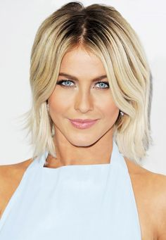 Julianne Hough makes a statement with platinum blonde hair paired with dark roots.