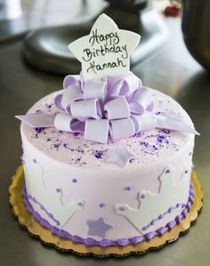 A purple birthday cake with princess crowns and stars. Cake # 022.