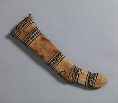 Sock Date: 12th–13th century Geography: Egypt, Fustat. Medium: Cotton Dimensions: H. 19 1/2 in. (49. 5 cm) W. 6 in. (15.2 cm)