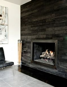 this is a great way to do a fireplace feature without a mantle and you could use the palet wall treatment to do it