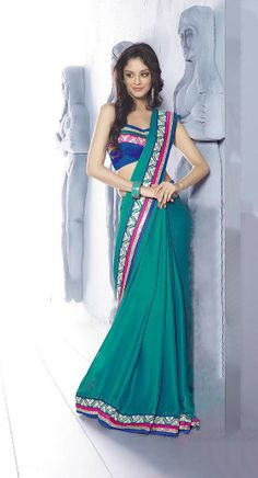 Green Color Designer Saree.We Create Best Shades To Enhance Your Beauty And Personality. Look Sensationally Awesome In This Saree