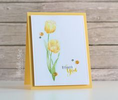 handmade card from The Card Grotto ... yellow tulips ... white embossed on watercolor paper and then water colored ... delighful!