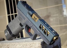 """Glock 19 grey frame with tungsten/blue titanium Cerakote, #zev trigger and @s3fsolutions fluted TiN barrel and…"""""""