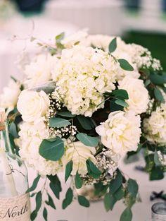 wedding reception centerpiece idea; featured photographer: Arielle Doneson Photography