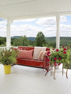 The front porch of fashion designer Cynthia Steffe's home, furnished with a vintage metal glider, offers a dreamy view of the Catskill Mountains.