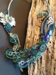 Check out this item in my Etsy shop https://www.etsy.com/listing/218595545/in-all-his-glory-peacock-bead-work