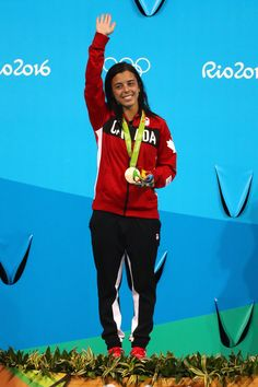 Bronze medalist Meaghan Benfeito of Canada celebrates on the podium during the medal ceremony for the Women's 10m Platform final diving contest at the Maria Lenk Aquatics Centre on day 13 of the 2016 Rio Olympic Games on on August 18, 2016 in Rio de Janeiro, Brazil.