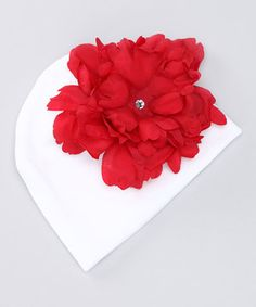 Any little seedling sporting this fancy accessory won't ever want to shed its added style and warmth. A vibrant flower with a rhinestone center sits atop the cozy velvet beanie, creating a fresh look.
