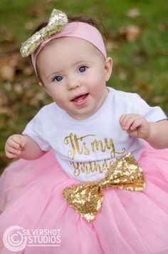 Baby girl first birthday pink gold white outdoors
