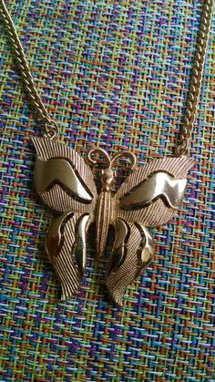 Check out this item in my Etsy shop https://www.etsy.com/listing/240609419/gold-butterfly-necklace-vintage-trifari