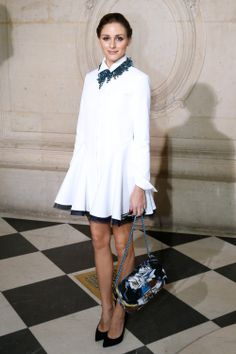 "Olivia Palermo wore a Dior white jersey dress, ""Diorganic"" necklace, and Miss Dior handbag to the brand's F/W 14 runway show."
