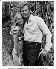 Roger Moore with his arm around Britt Ekland wearing a bikini in a scene from the film 'The Man With The Golden Gun' 1974